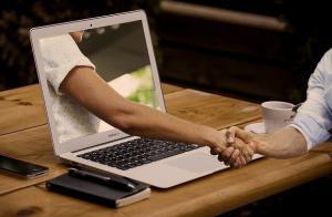 IT-Lösungen Handschlag
